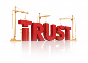 The word TRUST being constructed with cranes.